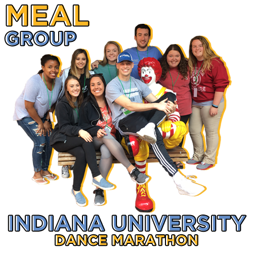 group of college kids sitting on bench with ronald mcdonald with graphic text overlay