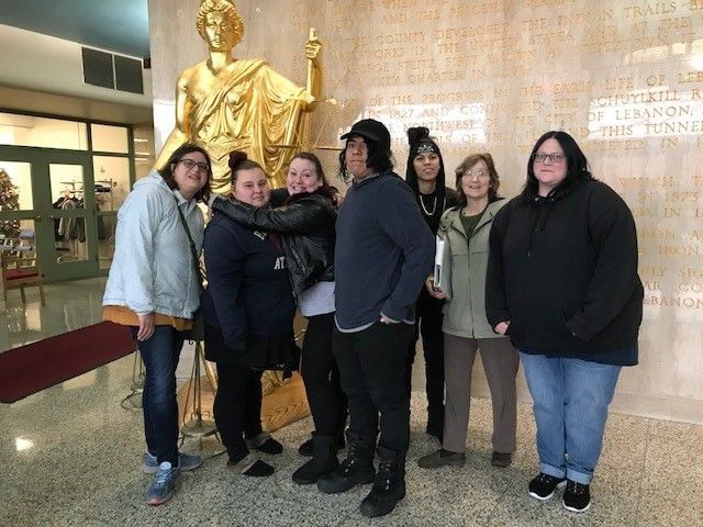 Group of HSE students in front of the golden statue at the Lebanon County Municipal Building.