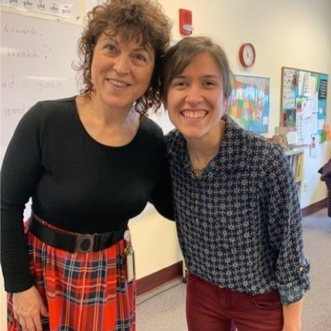 A teacher and intern posing together