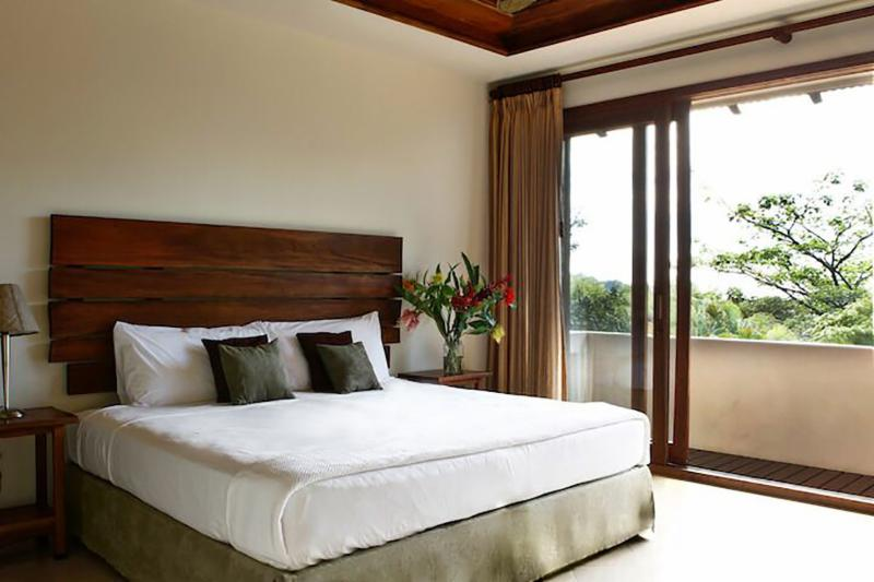 room with king size bed and balcony