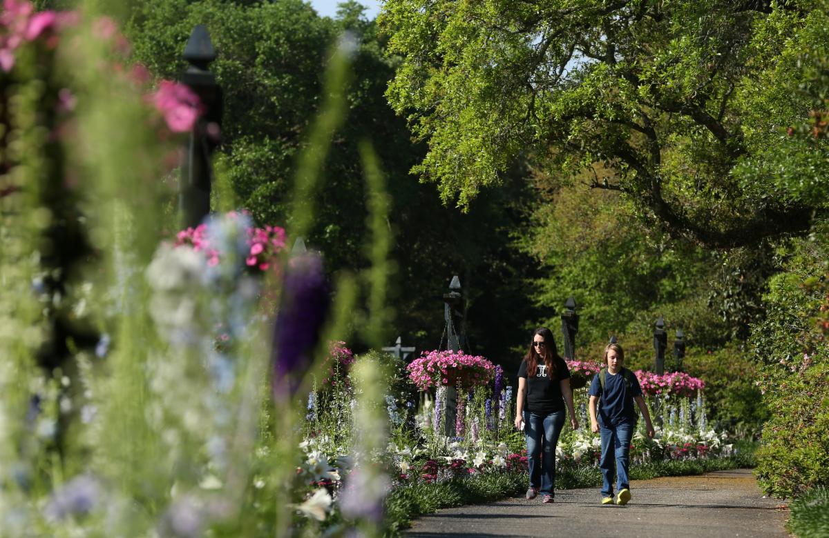 Two people walking at Bellingrath Gardens