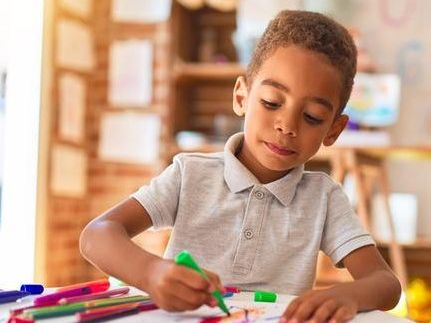 young boy coloring.jpg