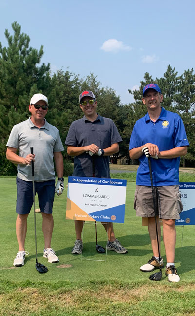 Lommen Abdo attorneys Brent Johnson Cameron Kelly and Jamie Johnson at the 2021 Hudson Daybreak Rotary Golf Tournament