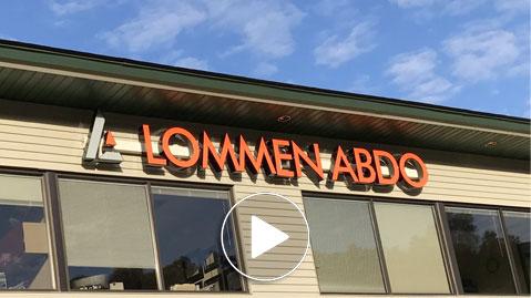 Lommen Abdo Law Firm logo on office building in Hudson Wisconsin