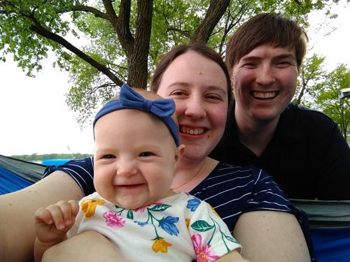 Benjamin with his wife and baby girl