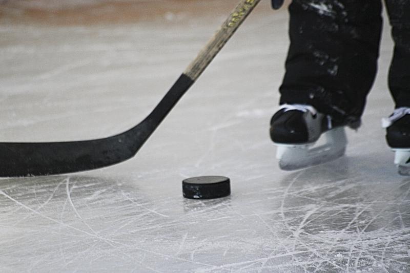 Hockey puck and skates