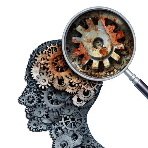 Brain decline and dementia or aging as memory loss concept for brain cancer decay or an Alzheimer s disease with old rusting mechanical gears and cog wheels in the shape of a human head with rust.