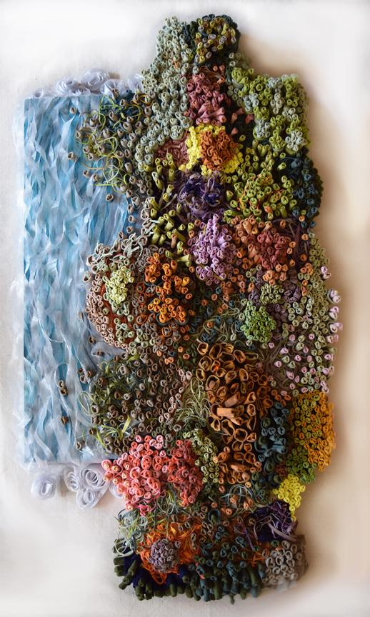 RipTied by Sooo-z Mastropietro - a collage of cut up fabric made too look like a lush garden bordering the ocean.