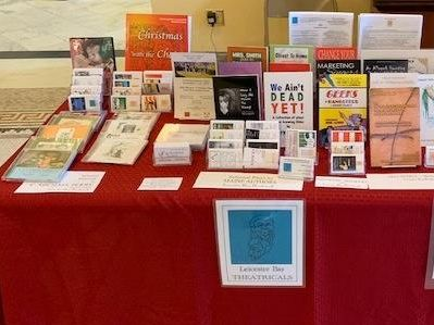 Display table at a fair exhibition of publishers Leceister Bay Theatrical's offerings