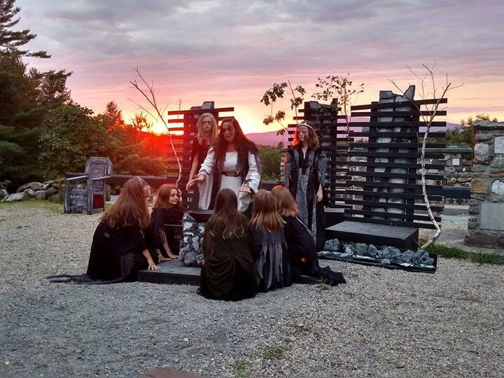 A performance of MacBeth at the Cathedral of the Pines: an outdoor amphitheater with minimal setting a a glorious sunset.