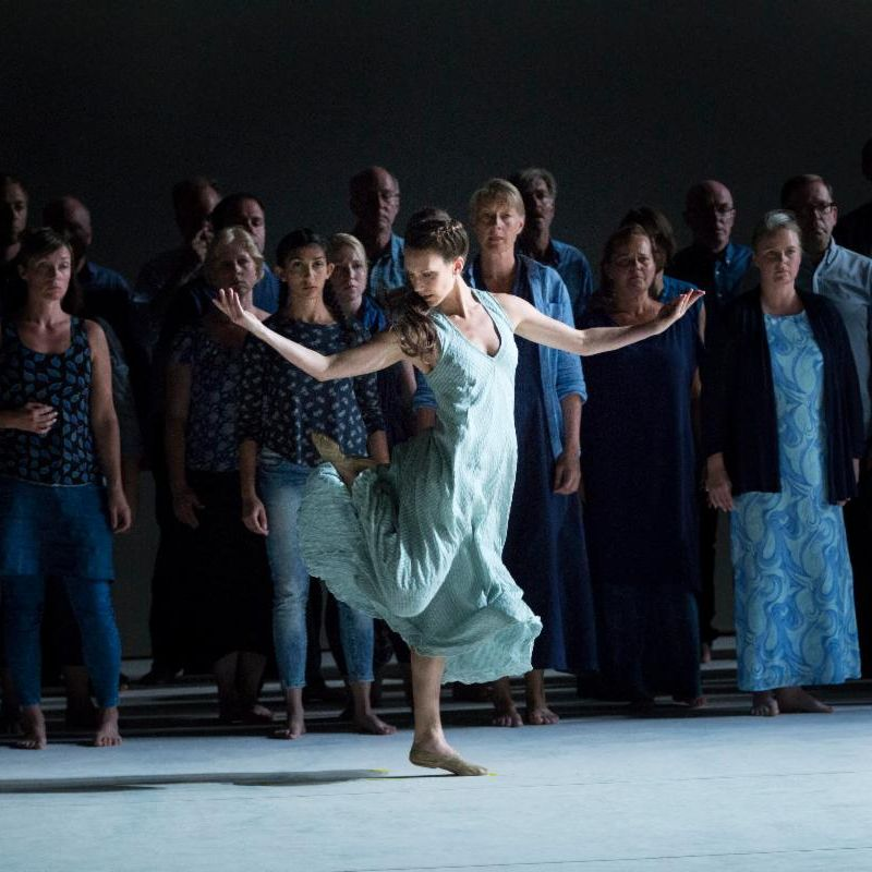 Laurel dances as Ismene in Oedipus - in a Greek folk dance style before a chorus of people dressed in blue.