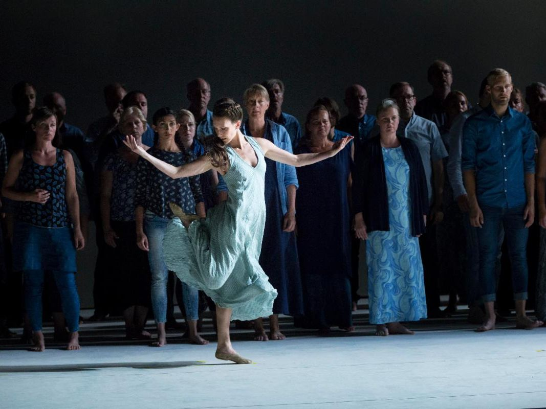 Laurel dances as Ismene in Oedipus. She looks carefree dancing on the breeze, except for the ominous crowd of the chorus behind her. Everyone is in shades of blue.