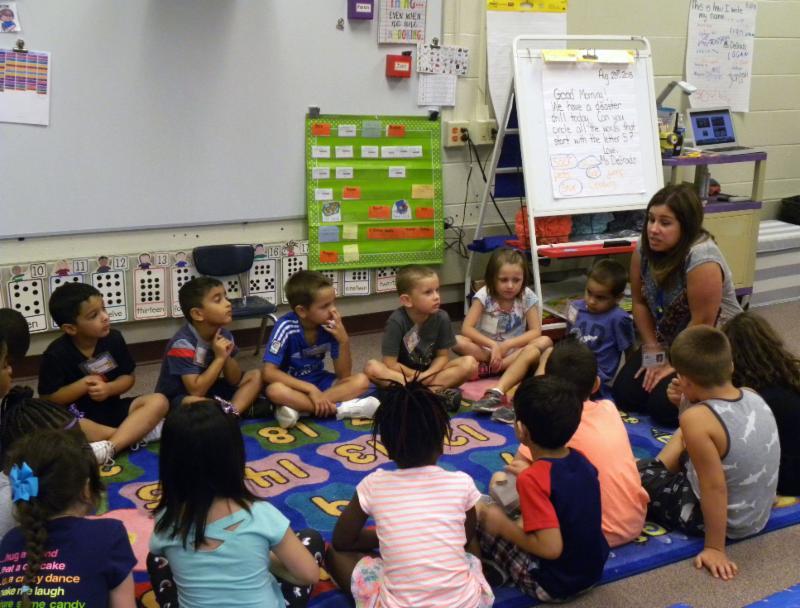Kindergarten students talk about their class turtle.