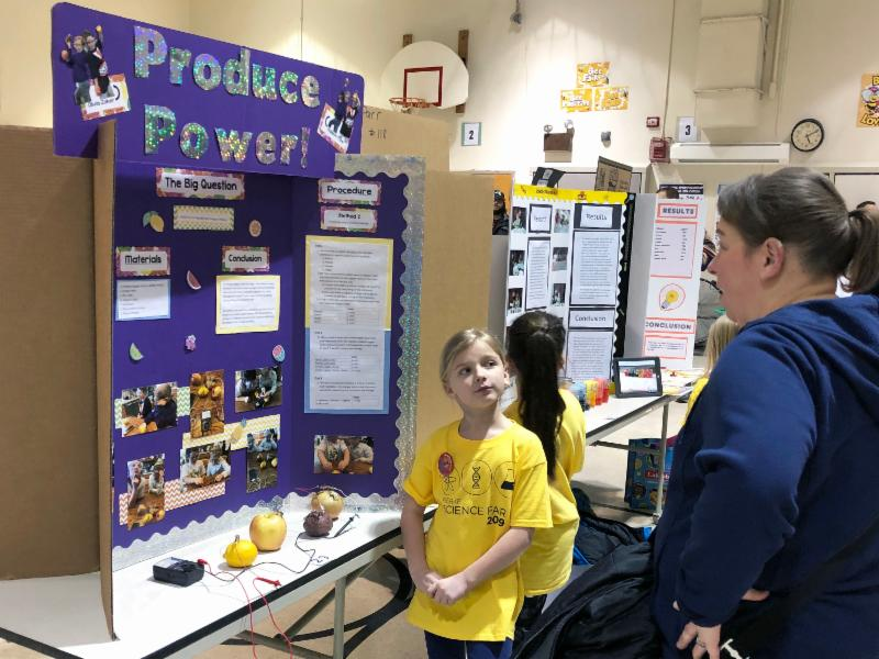A Fierke students shows off her science fair project.