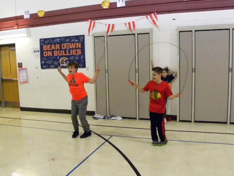 Two Memorial students jumping rope.
