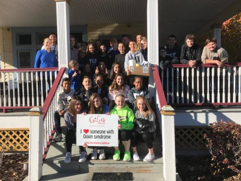 Central Middle School students outside of GiGi's Playhouse after volunteering at the organization.