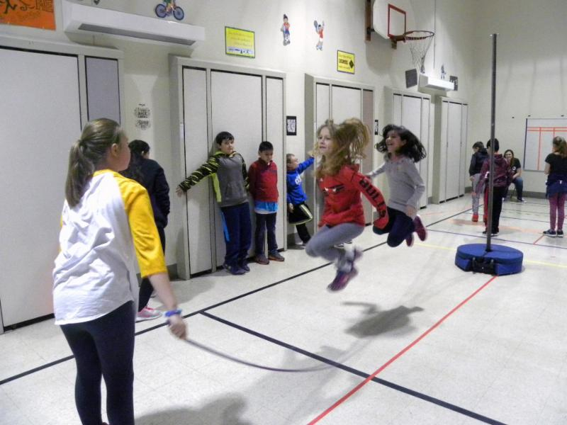 Three students at Fierke take part in the Jump Rope for Heart fundraiser.