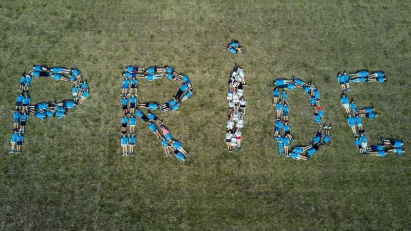 Band members spell out Pride on the field after marching band practice.