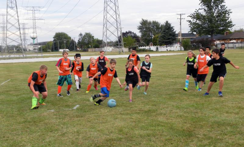 Students playing soccer during the Road to Central.