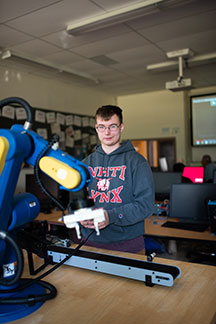 NHTI student working on robot in classroom