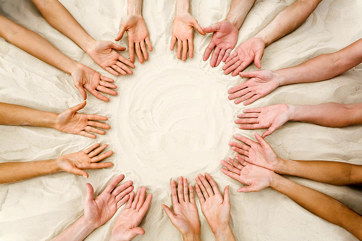 hands_together_sand.jpg