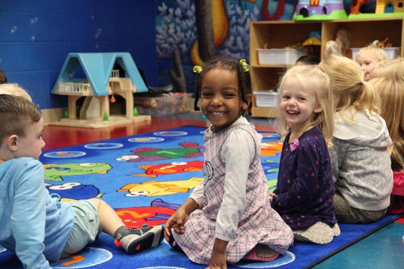 Preschool students smiling