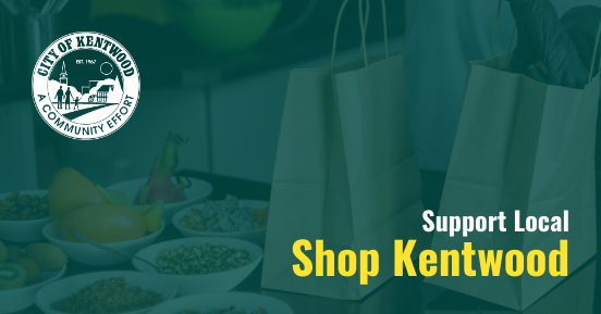 "Graphic features text that reads: ""Support Local. Shop Kentwood."" Background image is of a person wearing gloves packing a to-go meal into a brown paper bag. The City of Kentwood seal is in the top left corner."