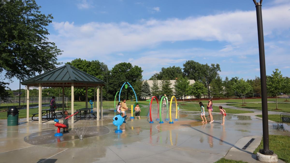Children play in the Veterans Memorial Park splash pad.