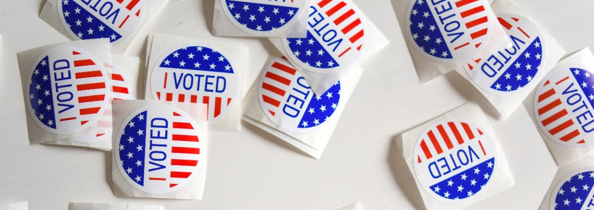 """Several """"I voted"""" stickers spread out on a surface."""