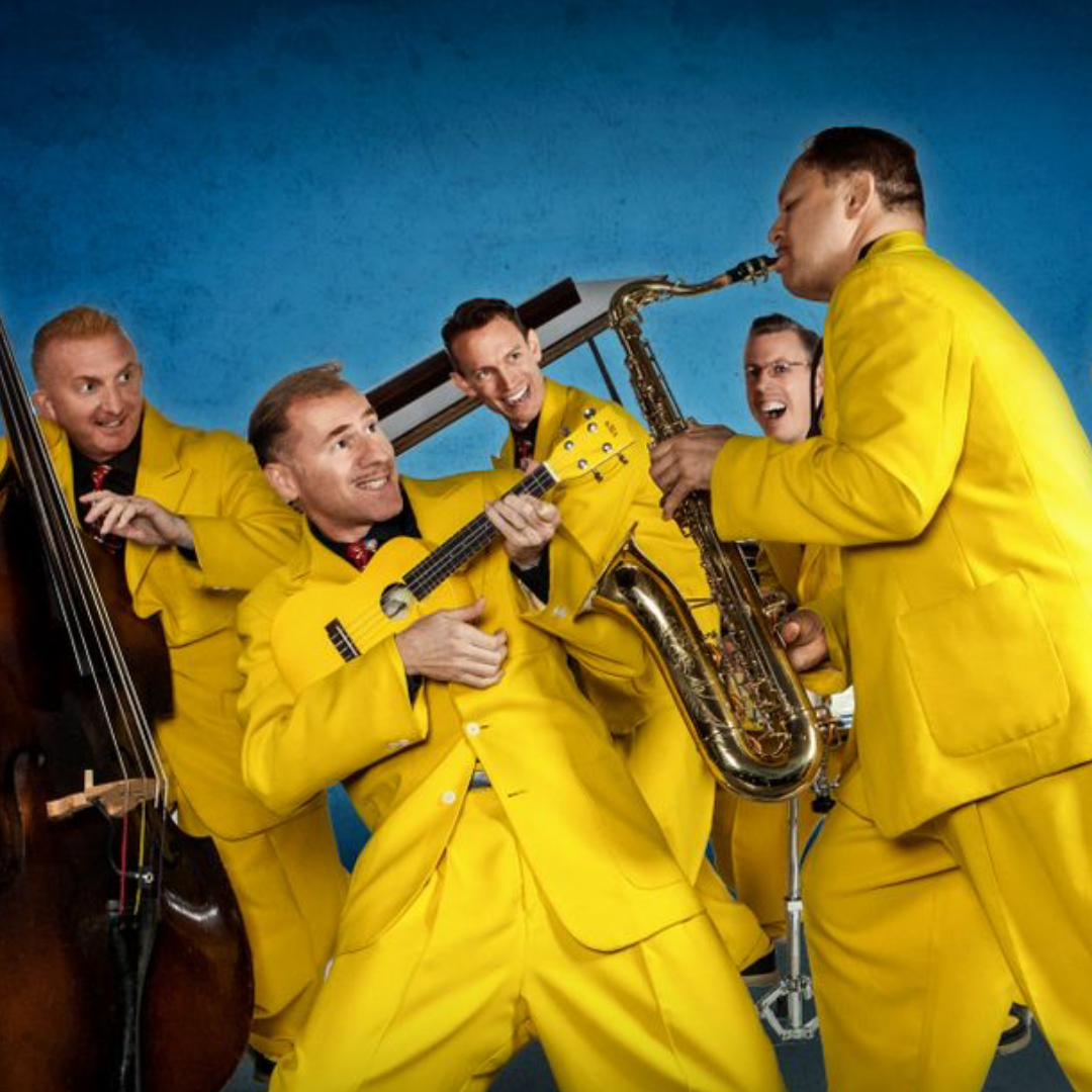 The Jive Aces in yellow suits playing instruments.