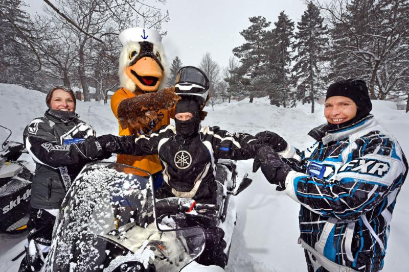 Pres. Mitchell readies on snowmobile