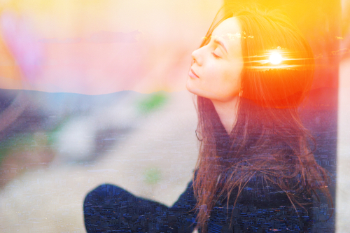 Double multiply exposure portrait of a dreamy cute woman meditating outdoors with eyes closed_ combined photograph of nature_ sunrise or sunset. closeup. Psychology power of mind inner voice concept.