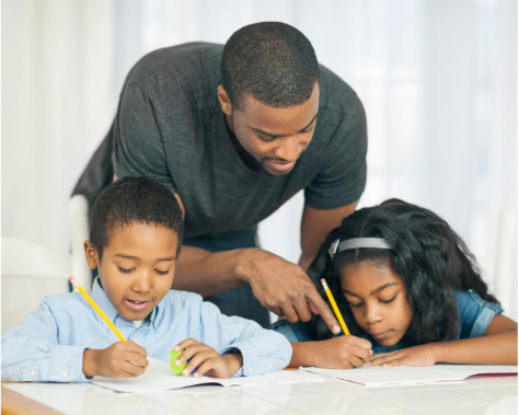 Photo of father homeschooling his kids