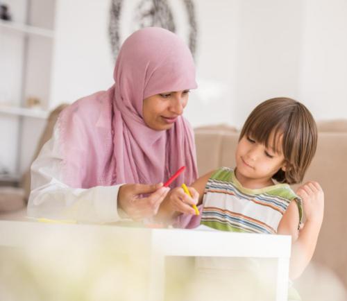 photo of parent homeschooling child