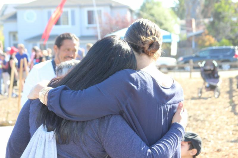 Two parks commissioners share a hug.