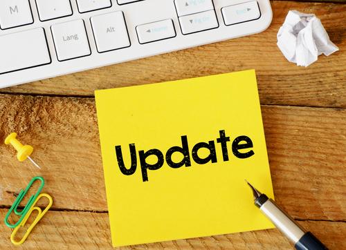 Update Update sticker with marketing plan inscription over computer keyboard