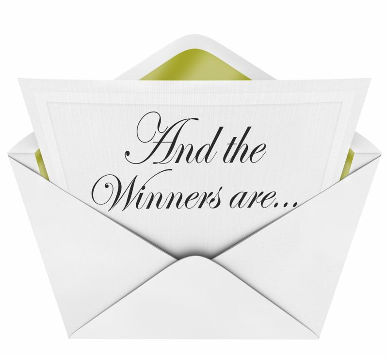 An opening envelope revealing a the names of winners in a competition or awards program