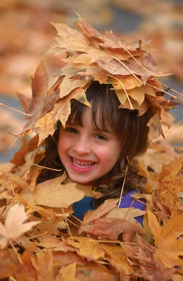 child-playing-leaves.jpg