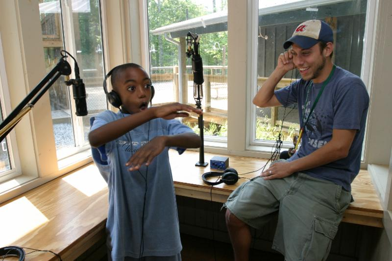 A camper and counselor have fun in the radio booth at Camp Twin Lakes.