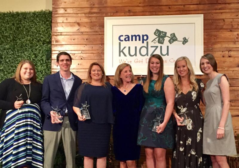 Alexandra Allen stands and smiles with members of the inaugural class of Camp Kudzu Ambassadors.