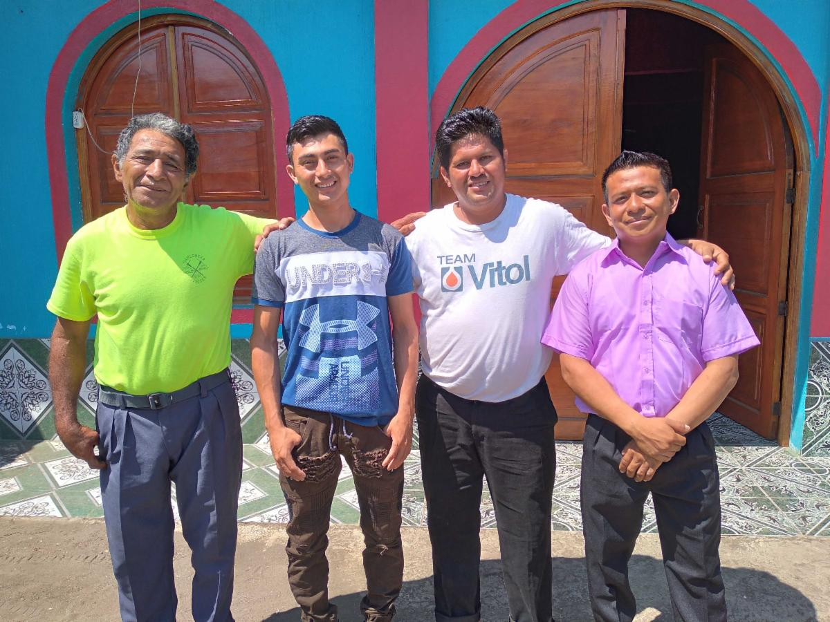 Pastor Samuel Rodas with the men who were rescued from drugs adiction_LR.jpg
