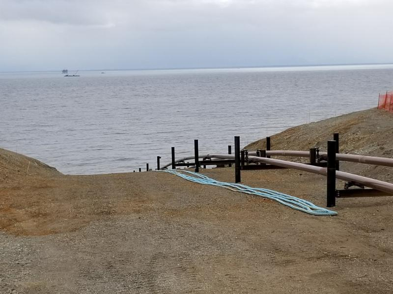06272018 Half-mile sections of pipe are staged at the beach cut to be pulled out by the barge