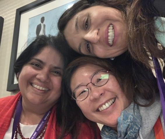 Image description: A selfie of three smiling Asian women