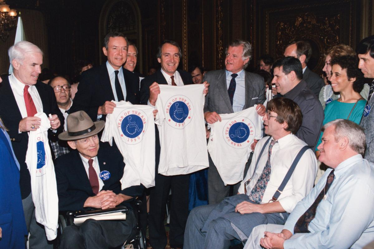 Crowd of congressional members and supporters the day the ADA was signed.