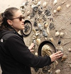Katie Kelel at an exhibit that can be touched at an aquarium
