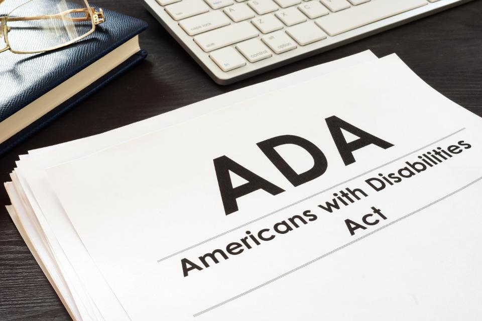 ADA Americans with Disabilities Act in paper form.