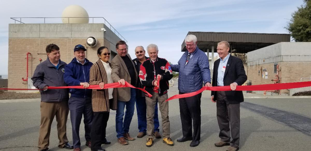 Grant Davis, General Manager of Sonoma Water stands with Valley Water Director Richard Santos as he cuts the ribbon at Penitencia Water Treatment Plant with representative from CA Department of Water Resources, Valley Water, NOAA, SFPUC and Alameda.