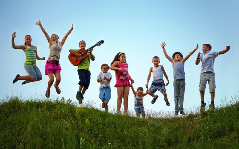 kids_jumping_on_hill.jpg