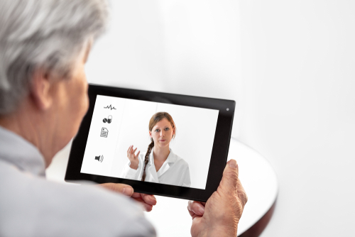 Telemedicine or Telehealth with a Doctor and a senior woman with tablet_ copyspace