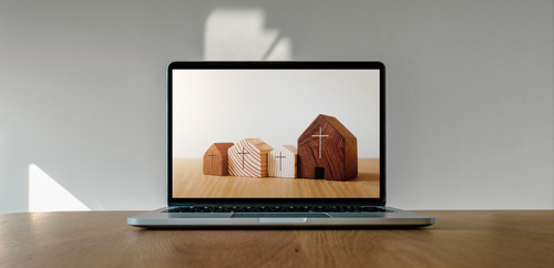 Worship from home_ Online live church for sunday service_ Laptop screen with wooden cross church photo on wooden table